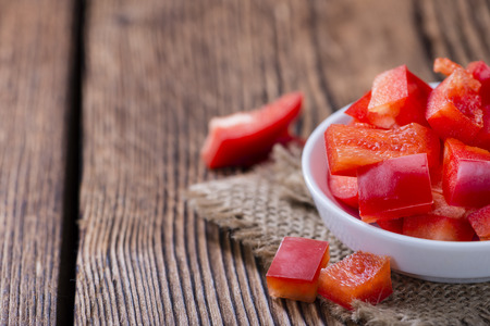red pepper: Portion of red Peppers (sliced; selective focus) on wooden background