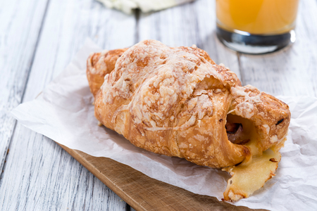 traditionally french: Ham and Cheese Croissant on an old wooden table (selective focus)
