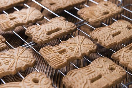 speculaas: Fresh baked Spekulatius (German cuisine) on rustic wooden background