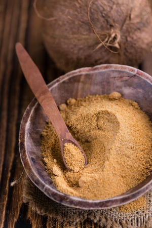 coconut sugar: Portion of golden Coconut Sugar (selective focus) on vintage wooden background Stock Photo