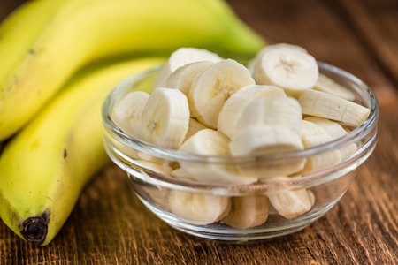 Chopped Bananas (detailed close-up shot) on vintage wooden background