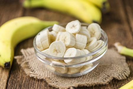 Sliced Bananas (detailed close-up shot) on wooden background