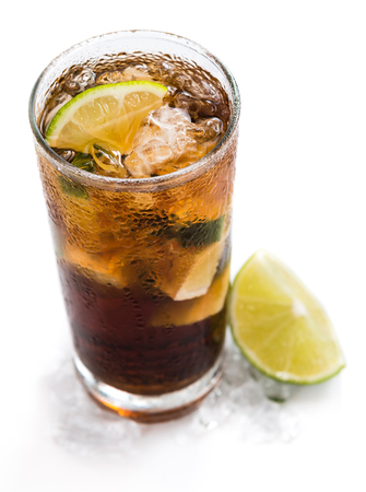 longdrink: Cuba Libre Longdrink with brown rum and lime (isolated on white background)