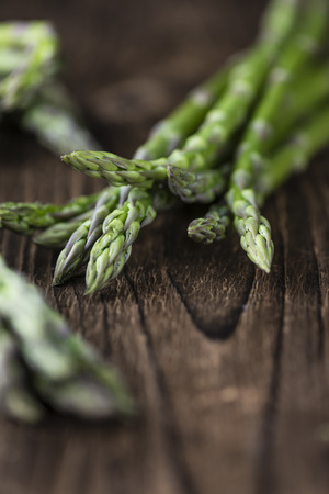nutritiously: Green Asparagus (fresh harvested) on an old wooden table (selective focus) Stock Photo
