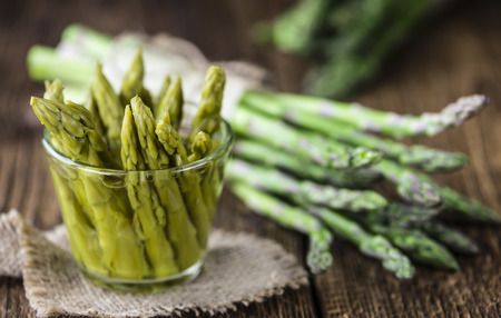 nutritiously: Preserved green Asparagus (selective focus) on wooden background