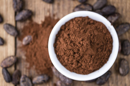 a portion: Portion of Cocoa powder (selective focus) as detailed close-up shot