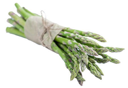nutritiously: Portion of green Asparagus (close-up shot) isolated on white background