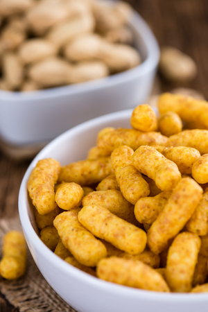 puffs: Crispy Peanut Puffs on wooden background (selective focus) Stock Photo