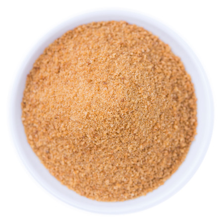 coconut sugar: Coconut Sugar (close-up shot) isolated on white background