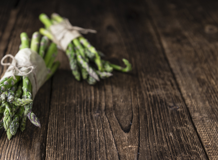 nutritiously: Green Asparagus (close-up shot) on vintage wooden background Stock Photo