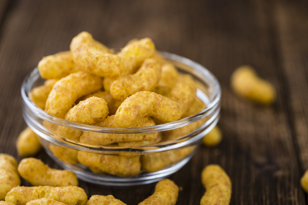 puffs: Portion of Peanut Puffs (selective focus) on vintage wooden background Stock Photo