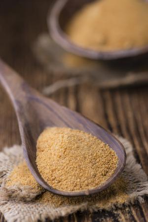 coconut sugar: Coconut Sugar (selective focus) on vintage wooden background