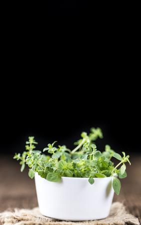 oregano plant: Oregano (detailed close-up shot; selective focus) on vintage wooden background