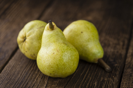Some fresh Pears (selective focus) on wooden background