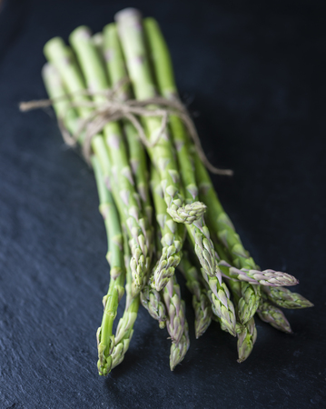 nutritiously: Green Asparagus (close-up shot) on a slate slab (selective focus) Stock Photo