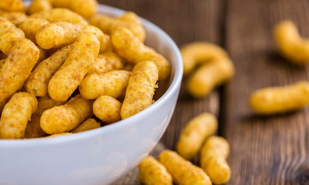 puffs: Some Peanut Puffs on wooden background (selective focus; close-up shot)