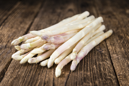 white asparagus: White Asparagus (selective focus) on wooden background (close-up shot)