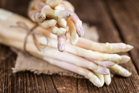 white asparagus: Portion of fresh white Asparagus as detailed close-up shot on wooden background (selective focus)