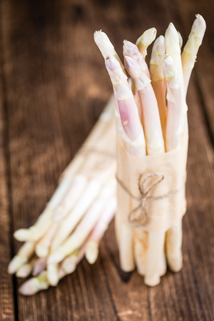 white asparagus: Portion of fresh white Asparagus (close-up shot) on wooden background