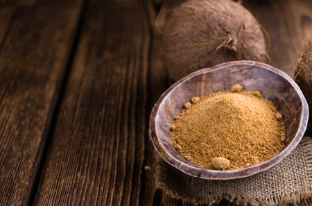 coconut palm sugar: Coconut Palm Sugar (selective focus) on an old wooden table Stock Photo