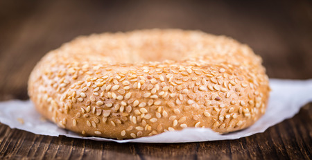 doughy: Fresh Bagels with Sesame (close-up shot; selective focus) on wooden background Stock Photo