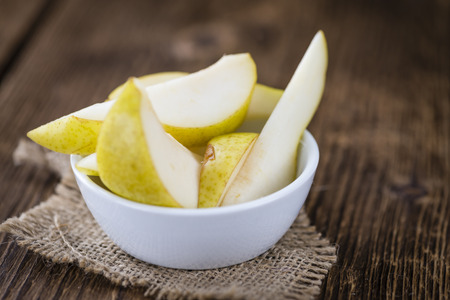 some: Some fresh Pears (selective focus) on wooden background