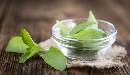 Portion of Stevia leaves (selective focus; detailed close-up shot) on vintage background 版權商用圖片 - 57114696