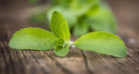steviol: Old wooden table with Stevia leaves (selective focus; detailed close-up shot) Stock Photo