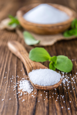 granules: Old wooden table with Stevia Granules (selective focus; close-up shot) Stock Photo
