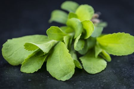 steviol: Some fresh Stevia leaves (selective focus) on a vintage looking background Stock Photo