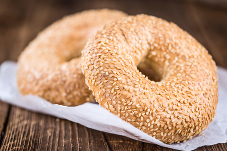 doughy: Sesame Bagels on an old wooden table (selective focus; close-up shot)