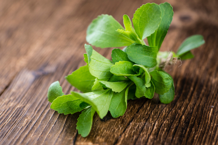 steviol: Vintage wooden table with Stevia leaves (selective focus; close-up shot)
