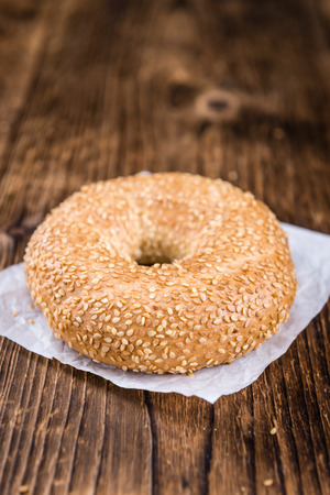 doughy: Bagels (with Sesame; selective focus) on vintage wooden background (close-up shot)
