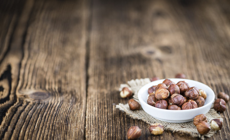 heap: Heap of Hazelnuts (selective focus) on vintage background (close-up shot)