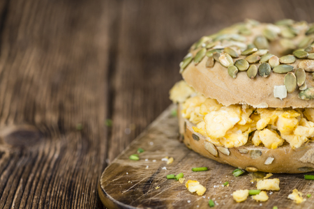 scrambled eggs: Scrambled Eggs on a Bagel (selective focus; detailed close-up shot) Stock Photo
