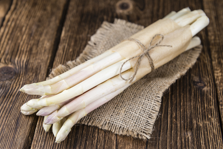 white asparagus: Bunch of fresh white Asparagus (close-up shot; selective focus) on wooden background Stock Photo