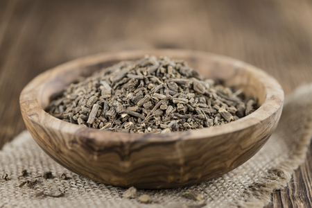 Heap of valerian roots (close-up shot)on vintage wooden background