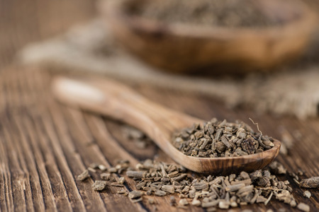 Valerian Roots on a wooden table (detailed close-up shot) Stock Photo