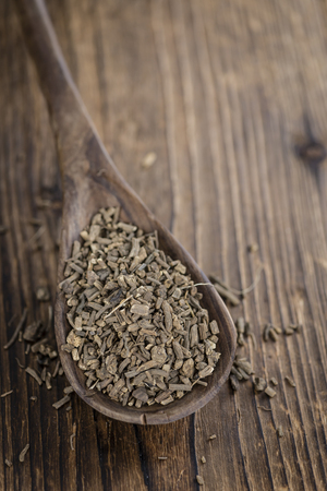 valerian: Dried Valerian roots (detailed close-up shot) on wooden background
