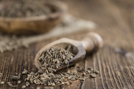 valerian: Heap of valerian roots (close-up shot)on vintage wooden background