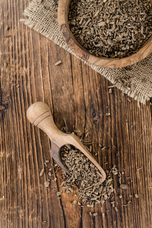 valerian plant: Valerian roots (dried; detailed close-up shot) on wooden background