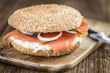 detailed shot: Fresh made Bagel with Salmon (selective focus; detailed close-up shot)