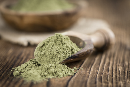Stevia leaf powder (detailed close-up shot) on rustic wooden background
