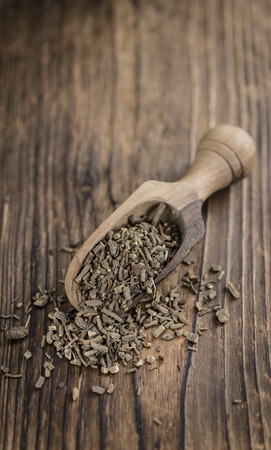valerian plant: Dried Valerian roots (detailed close-up shot) on wooden background