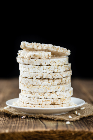 Some Rice Cakes on an old wooden background (detailed close-up shot)