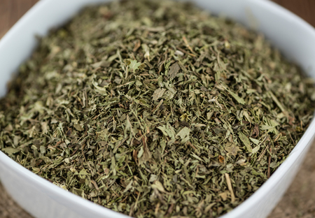 steviol: Heap of dried Stevia leaves (sweetener) on vintage background (close-up shot) Stock Photo