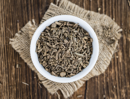 Dried Valerian roots (detailed close-up shot) on wooden background