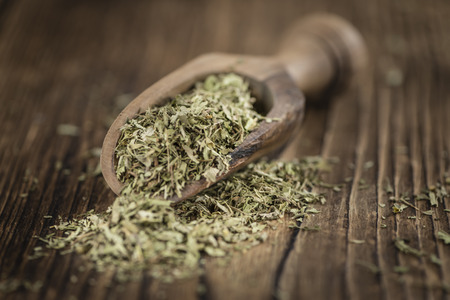 Dried Stevia leaves (selective focus) on vintage background