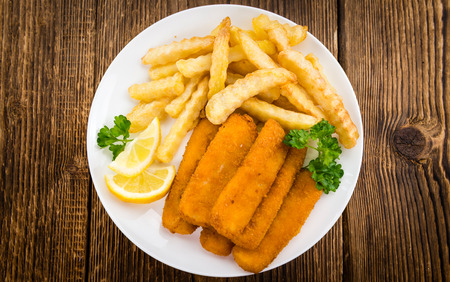 fishfinger: Fried Fish Fingers (selective focus) on wooden background (selective focus) Stock Photo