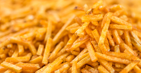 a portion: Portion of Potato Sticks (close-up shot) for use as background image or as texture